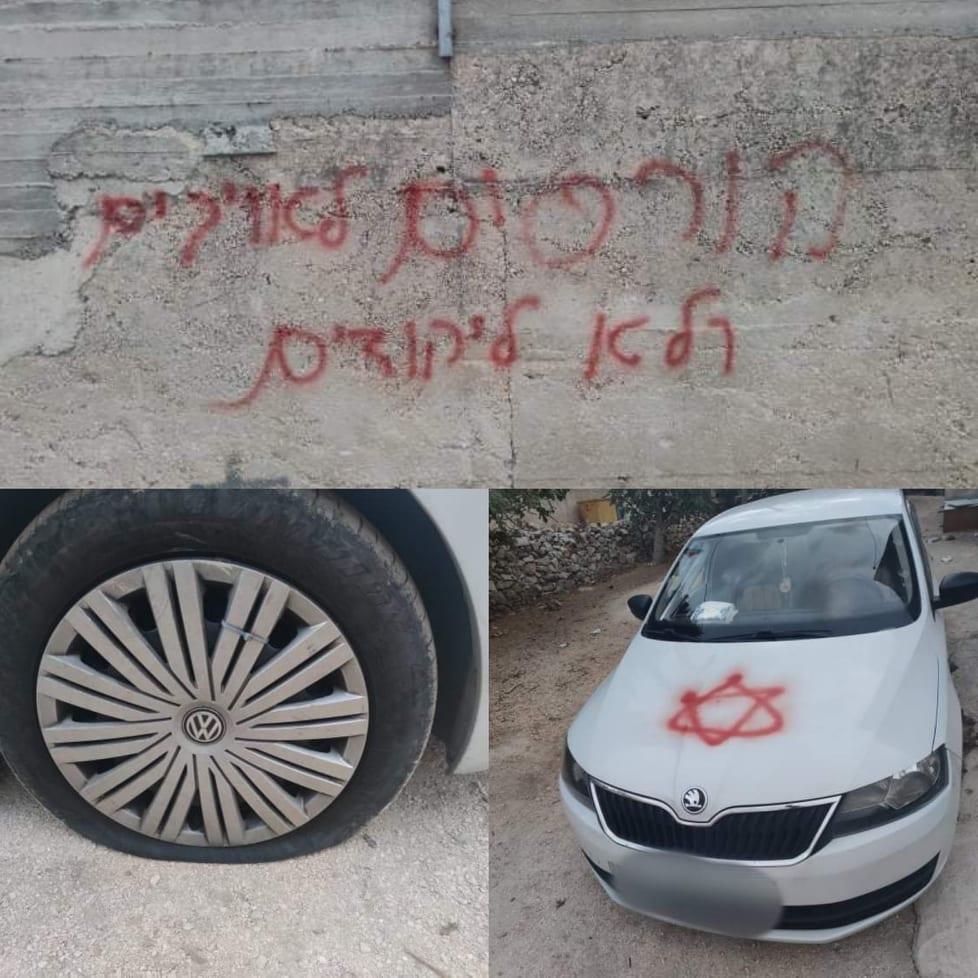 (محدث) مستوطنون يعطبون إطارات مركبات ويخطون شعارات عنصرية في قرية مردا